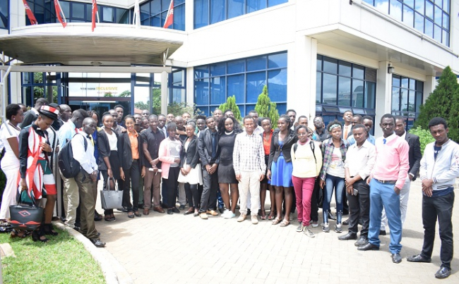 East Africa Institute of Certified Studies pose for a photo outside The Standard Group PLC.