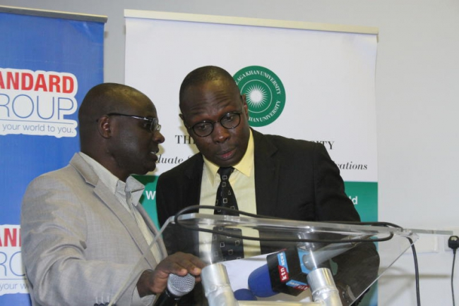 Standard Group editor in chief Ochieng Rapuro (right) talks to the Director of human resources Nicholas Siwatom