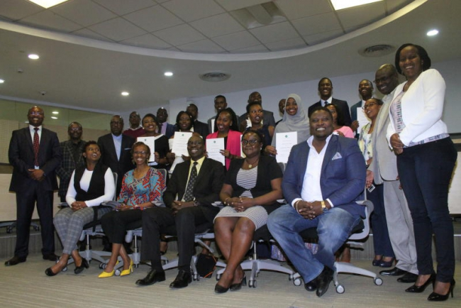 Some of the senior managers at the Standard group pose for a photo with Standard media academy 2020 class graduands