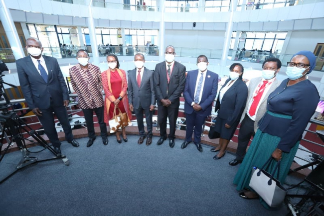 ICT CS Joe Mucheru (center) pose for a picture with Visitors and Board members of Standard Media Group  at new newsroom
