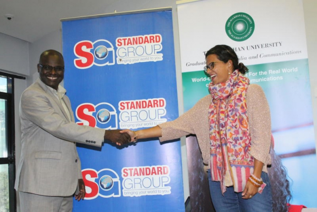 Standard Group Nicholas Siwatom shakes hands with senior manager broadcast at graduate school of media and communication at the Agakhan university Soraiya Shah at the AgaKhan university