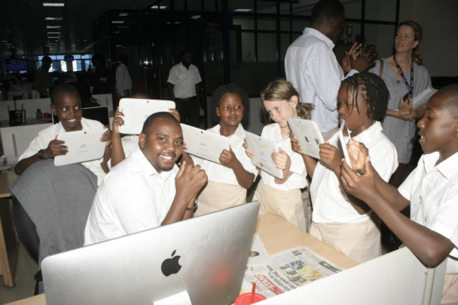 Students of Hillcrest Preparatory school take photos of Generation next editor Thorn Mulli with their school ipads during a tour of the school to Standard Media Group Headquarter located along Mombasa