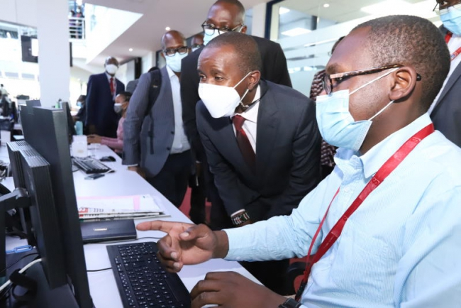 Standard Media Editorial Director Ochieng' Rapuro tours ICT Cabinet Secretary Joe Mucheru and other board members in the newsroom during the launch of the new Standard Newspaper