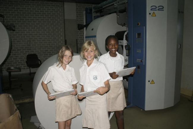 Hillcrest preparatory school students at the printing press  during a tour of the standard media group