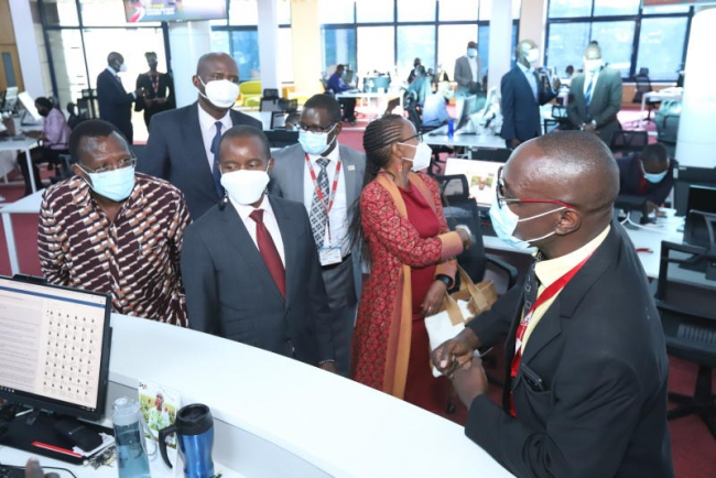 Standard Media Editorial Director Ochieng' Rapuro takes guests ICT Cabinet Secretary Joe Mucheru and other board members for a tour in the newsroom