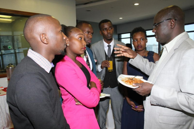 Director of human resources at Standard Group Nicholas Siwatom shares a word with a section of Standard media academy 2020 class graduands