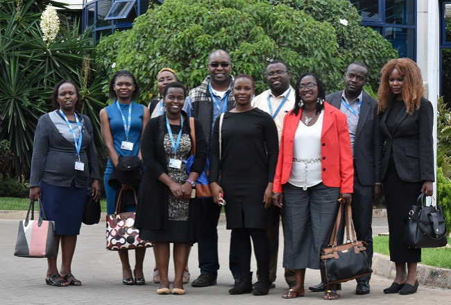 Daystar University pose for a photo outside The Standard Group PLC.