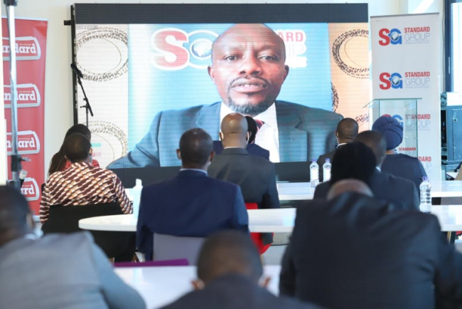 Standard Group CEO Orlando Lyomu addresses the guest through zoom during the launch