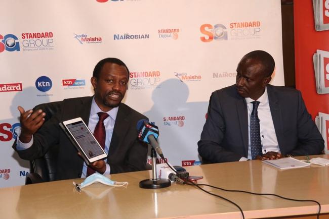 Group CEO Orlando Lyomu shows how the E-papaer on an ipad smart gadget as KNUT Secretary General Hon. Wilson Sossion looks on