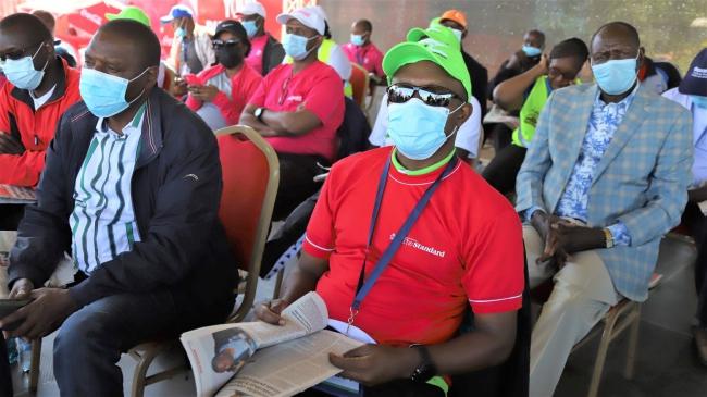 Standard Group CEO Orlando Lyomu (centre), with other sponsors during Eldoret City Marathon