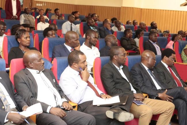 Members of public follow proceedings