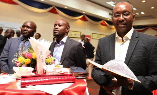 From left,Former marathoner Moses Tanui, Standard Group CEO Orlando Lyomu and Head of Cooperate Affairs Charles Kimathi, follow the speeches during Standard Group's cocktail