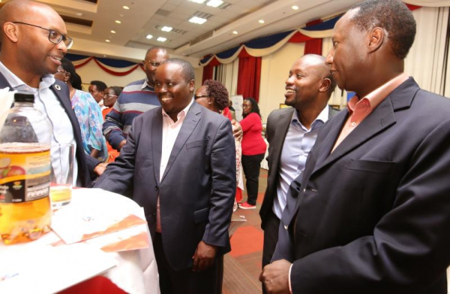 Standard Group CEO Orlando Lyomu (second right), Eng Alex Tolgos, Non Executive Directors) and Mr Samuel L. Tiampati (right) and one of the stake holders — at Boma Inn Eldoret.