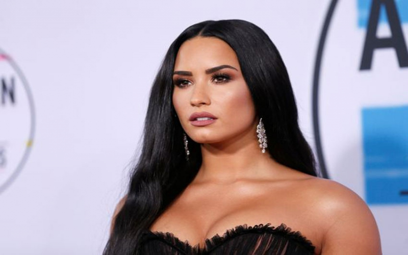 Demi Lovato says she's a 'fighter' as she opens up about mental health a year after overdose