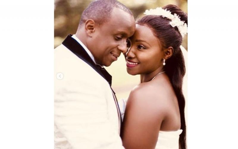 Catherine Kamaus touching post to Phil on second wedding anniversary