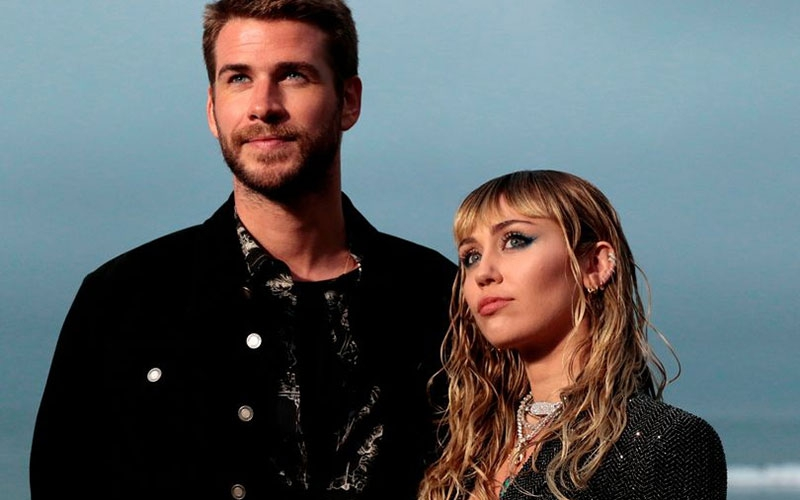 Liam Hemsworth files for divorce after Miley Cyrus kisses woman