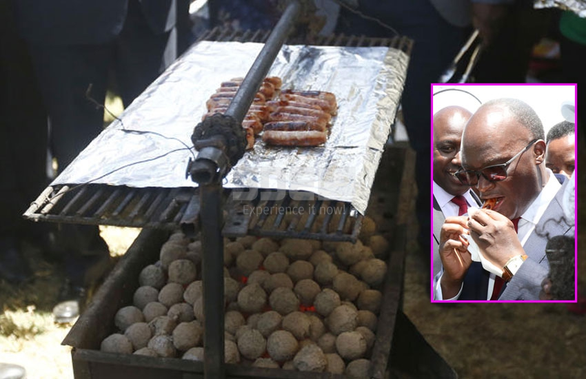 CS Macharia savours sausages made from jiko fuelled by human waste