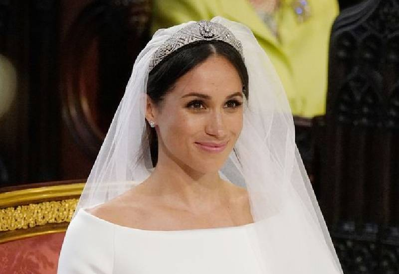 Meghan Markle's choice of wedding dress 'surprised' The Queen, claims royal source