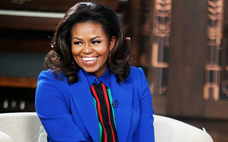 Be there for each other, Michelle Obama urges women