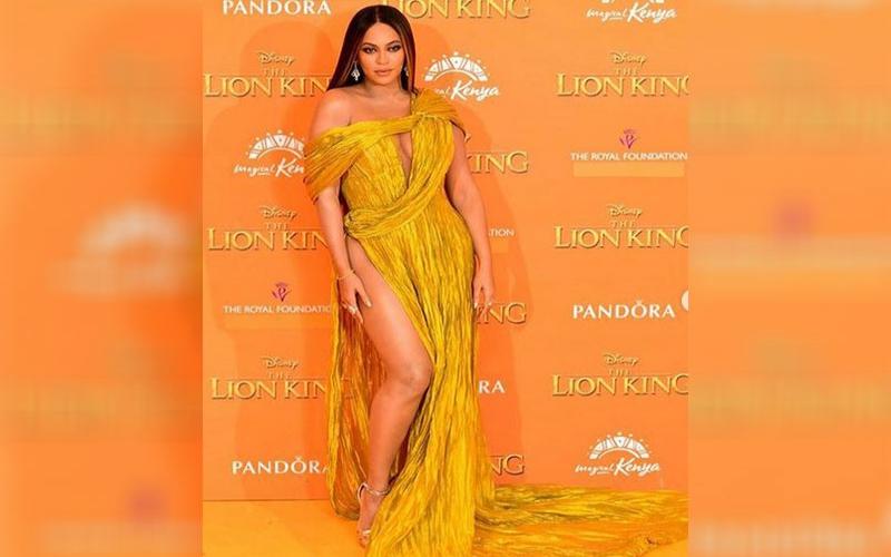 Beyoncé glows in yellow at The Lion King London premiere