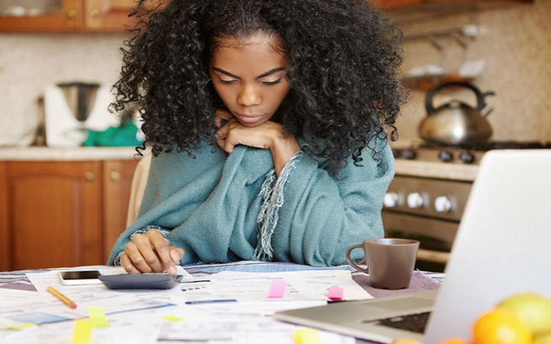 Confessions: My husband lives large yet we are drowning in debt, help!