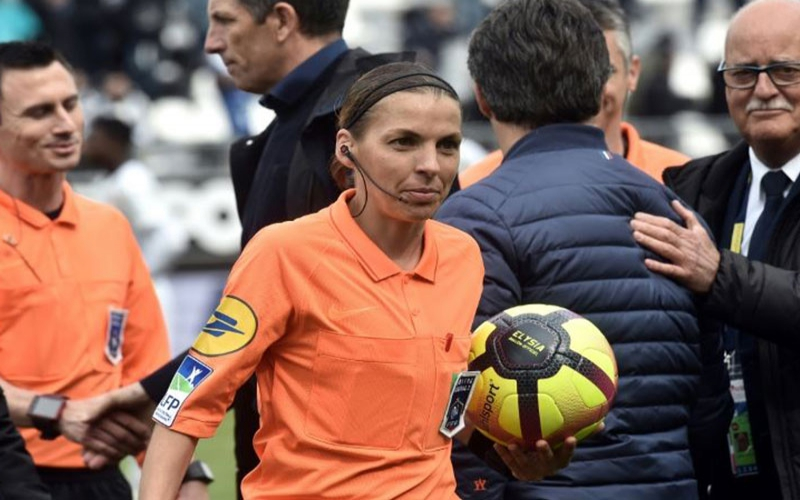 Female referee schools male footballers in tough match [Photos]