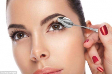Curl your eyelashes with a spoon.