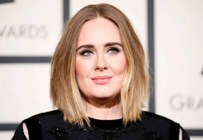 Adele says she wrote upcoming album for her son