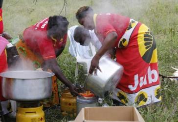 Volunteer women offer Lake Nakuru rescue team food