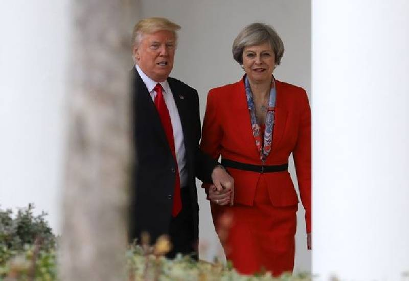 Panicked Theresa May phoned husband to explain Donald Trump hand-holding