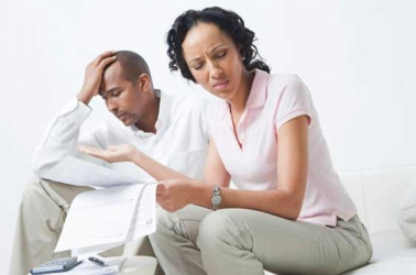 Should  married couples conceal their financial credentials?
