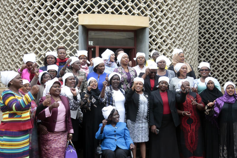 Kenyan female MPS march to parliament in white head scarfs