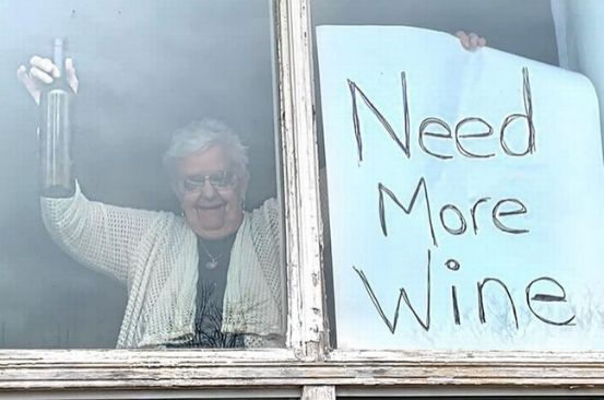 Grandma, 82, makes huge sign asking for more wine after drinking it all during lockdown