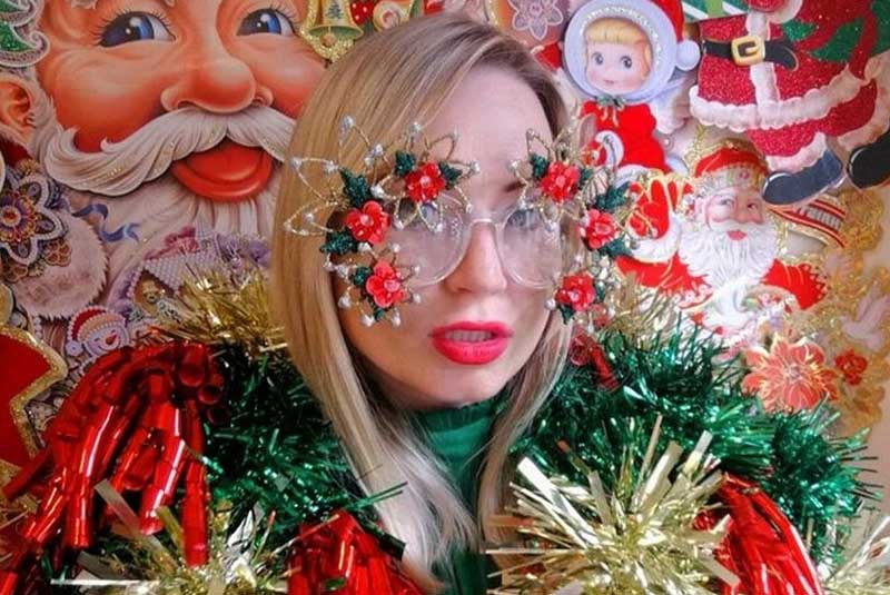 Christmas-obsessed fashion designer wonders if she was a Xmas tree in her past life