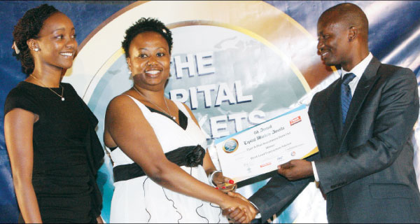 Diamond Trust Bank staff members  join their CEO Nasmin Devji (middle) in celebrating her award for CEO of the Year during the 4th Annual Capital Markets Awards organised by Think Business at Hotel Intercontinental on Wednesday. [Photo: Jonah Onyango/STANDARD]