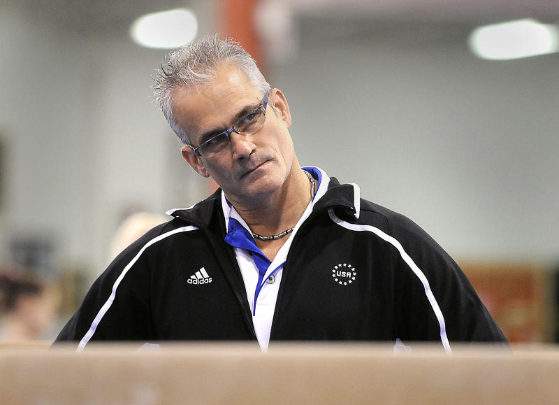Former Olympics coach dies by suicide after being charged