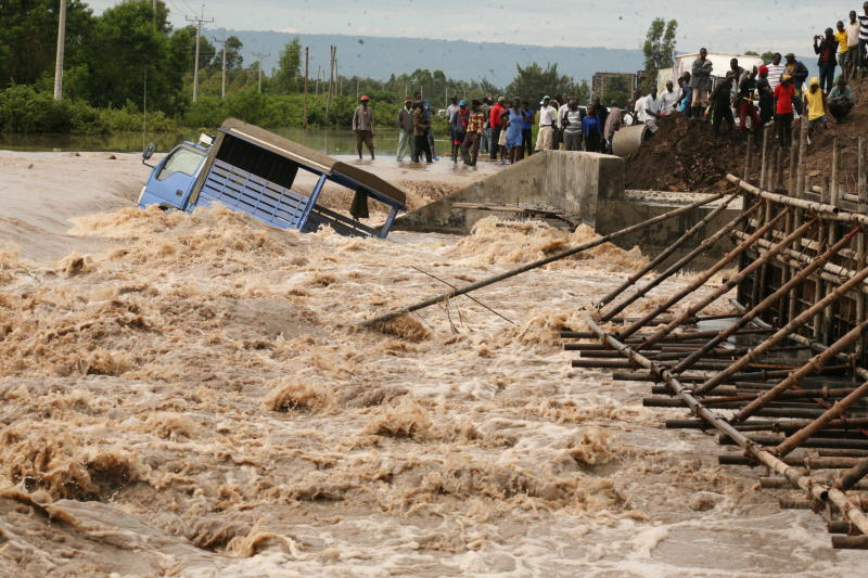A vehicle is swept away after floods cut-off Katito-Ahero road. (Photo: Denish Ochieng)