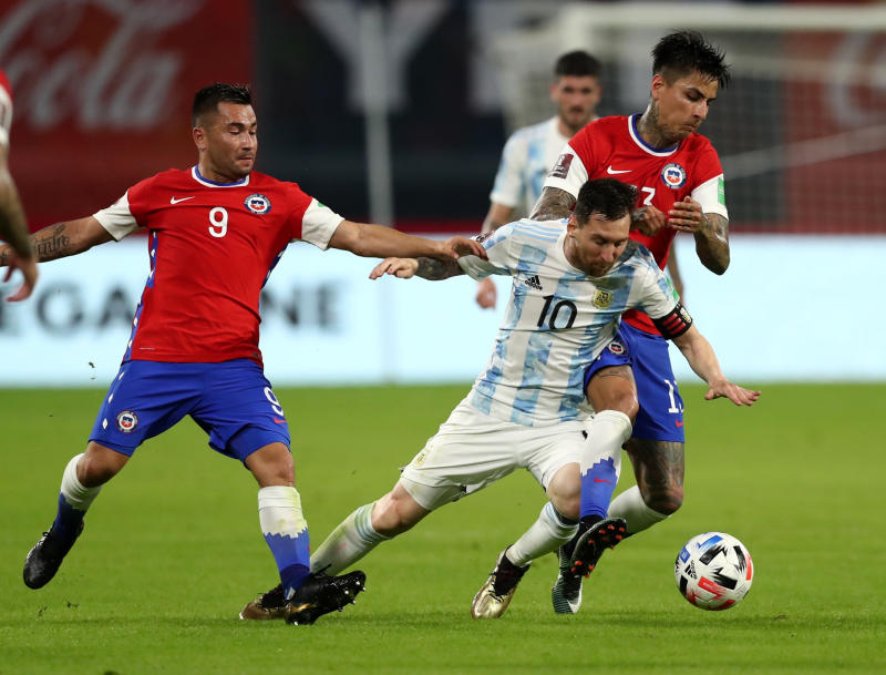 Messi scores penalty but Argentina held by Chile in 2022 qualifier