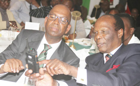 Safaricom Chief Executive Officer Bob Collymore (left) and Kara chairman Richard Nyaga during the Kara/Safaricom luncheon yesterday. [PHOTO: Moses Omusula]