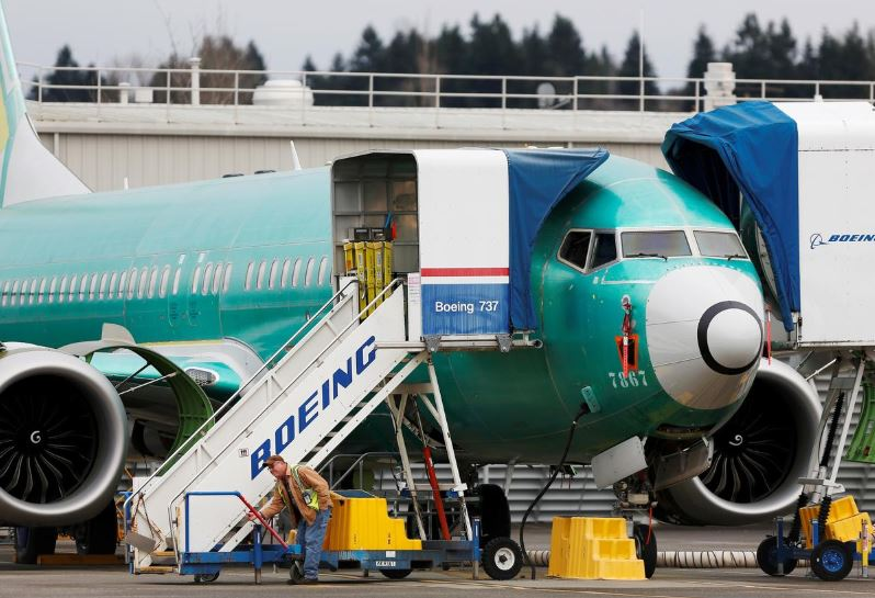 An employee works near a Boeing 737 Max aircraft at Boeing's 737 Max production facility in Renton, Washington, US December 16, 2019. REUTERS/Lindsey Wasson/File Photo