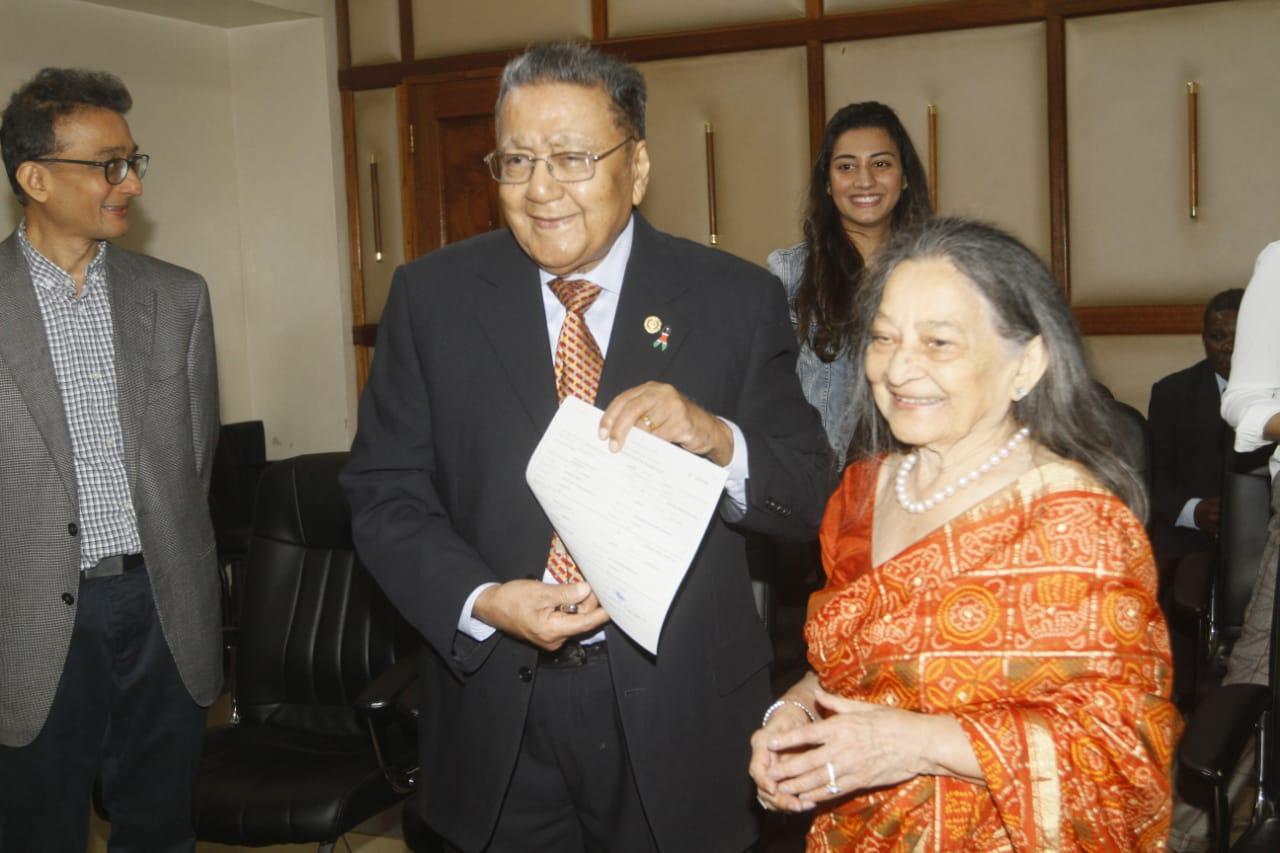 Businessman Manu Chandaria and his wife Aruna Chandaria displaying his marriage certificate (Photo: Jenipher Wachie)