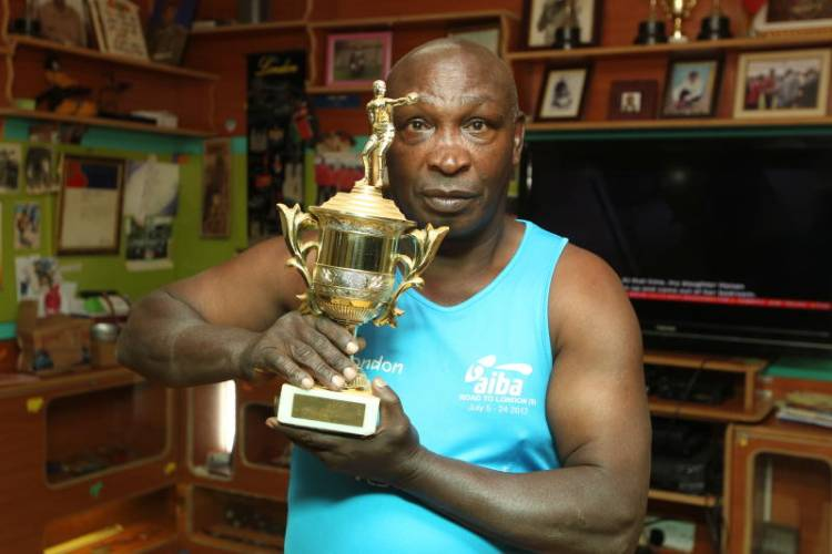 Boxing legend lives a quiet, simple life tending to his fowls