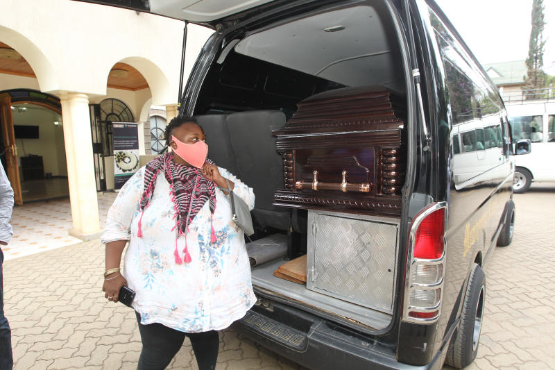 Hannita Njoki (Wafirethi) views casket bearing the remains of the late Papa Shirandula at Montezuma Monalisa Funeral Home. (Photo: Jonah Onyango)