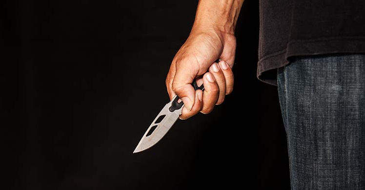 Father on the run after attacking teenage son with knife