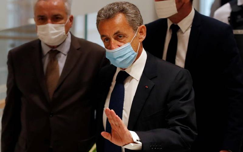 Former French president Sarkozy jailed for trying to bribe a judge