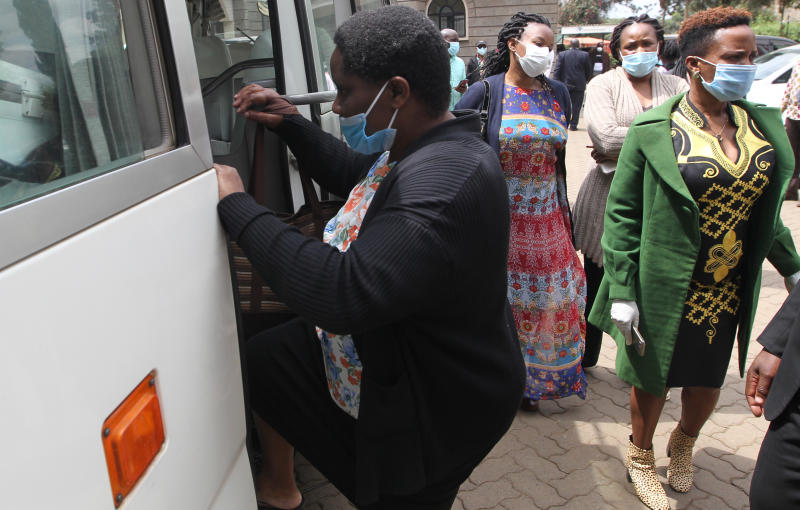 Beatrice Ebbie (left) Widow of the late Papa Shirandula accompanied by relatives board a vehicle before leaving Montezuma Monalisa Funeral Home. (Photo: Jonah Onyango)