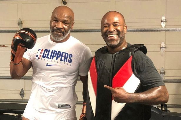 Mike Tyson shows off great physique after making boxing return announcement [Photos]