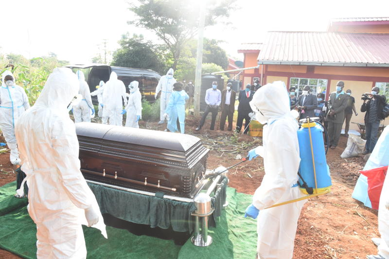Casket containing the body of the late actor Charles Bukeko being fumigated at the graveside at Bukeko village in Busia County (Photo: Benjamin Sakwa)