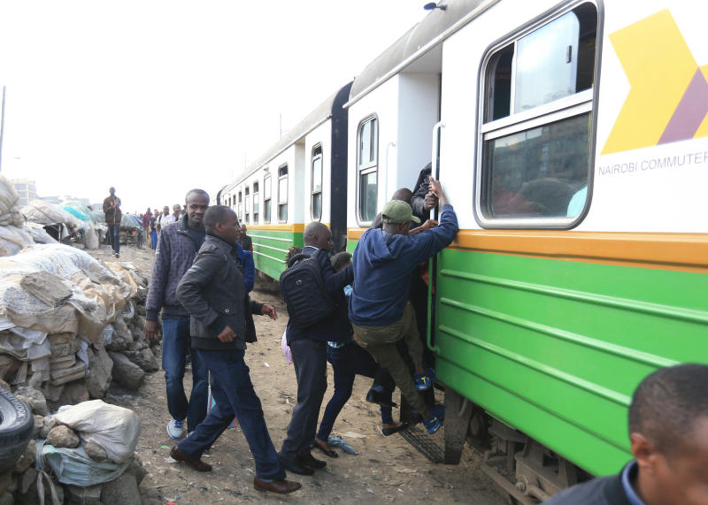 Passengers travelling to Nairobi's CBD scramble to board a commuter train at Pipeline station in Embakasi despite the new directives by the Government to observe social distancing to curb spread of Co