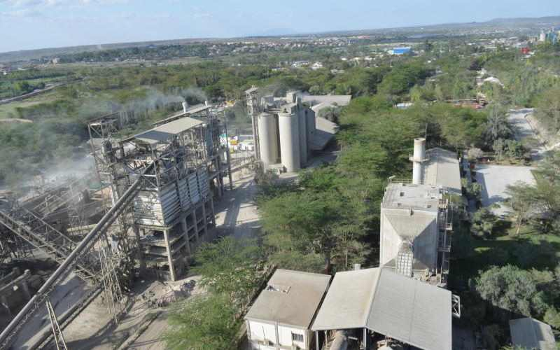 Cement maker cuts loss on lower costs